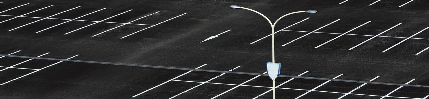 Asphalt Parking Lot with Light Post